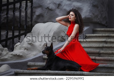 Young beautiful caucasian brunette posing over city background - stock photo