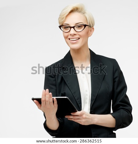 Young beautiful caucasian business woman wearing jacket studio portrait - stock photo