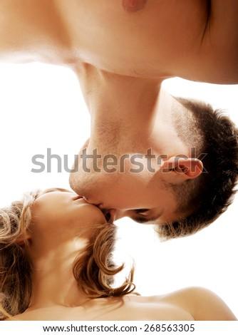 Young beautiful caucasian couple kissing. - stock photo