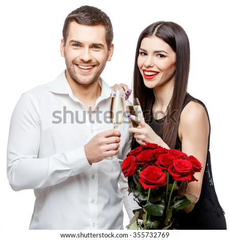 Young beautiful caucasian couple with flowers isolated on white - stock photo