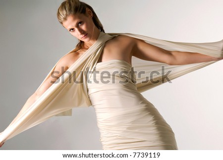 Young beautiful caucasian girl dressed in ancient style robe - stock photo