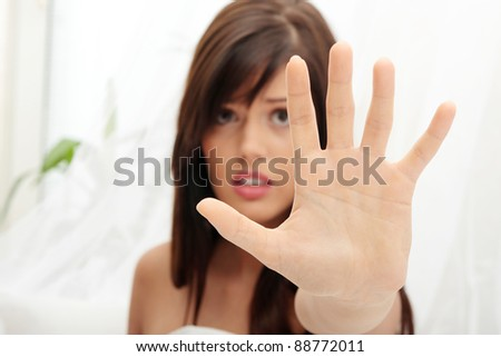Young beautiful caucasian woman in bed abused - stock photo