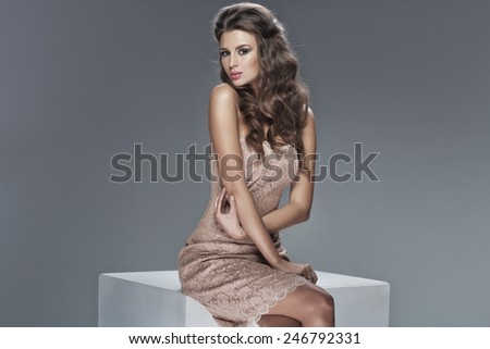 Young beautiful caucasian woman in gorgeous dress - stock photo