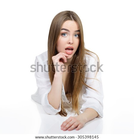Young beautiful caucasian woman posing against white background. Studio portrait of pretty girl. - stock photo
