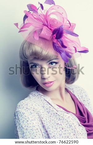 Young beautiful caucasian woman wearing a fancy hat with feathers, romantic style look - stock photo