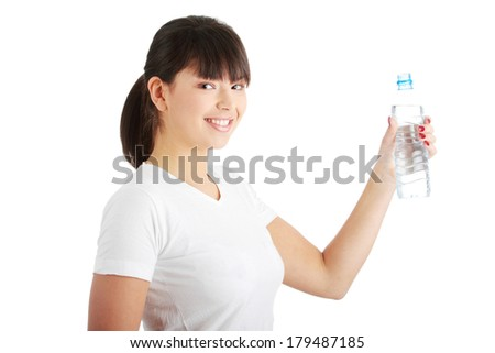 Young beautiful caucasian woman with bottle of mineral water, isolated on white background