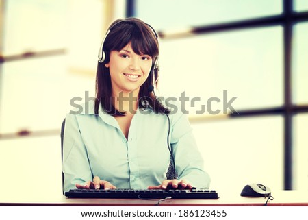 Young beautiful caucasian woman working in call center