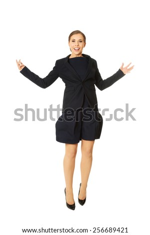 Young beautiful cheerful businesswoman jumping - stock photo