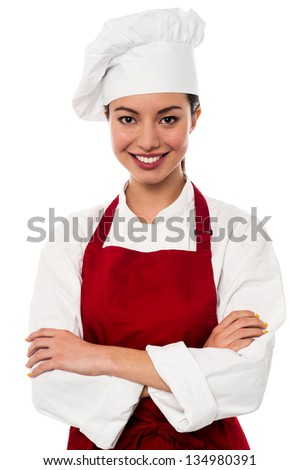 Young beautiful chinese female chef posing with confidence. - stock photo