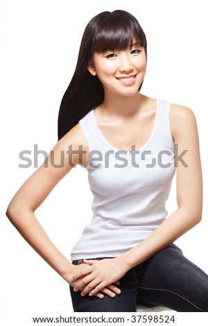 Young, beautiful chinese girl dressed casually in white singlet and jeans - stock photo