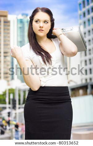 Young Beautiful City Lawyer Solicitor Or Legal Representative Holding Business Briefcase Walking On The Inner City Streets To Next Court Appointment - stock photo