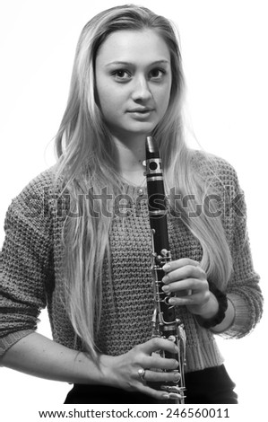 Young beautiful clarinetist playing.