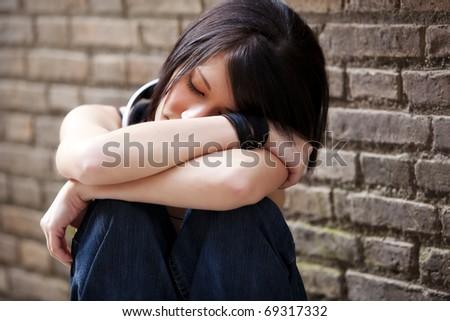 Young beautiful closed eye girl on urban background. - stock photo