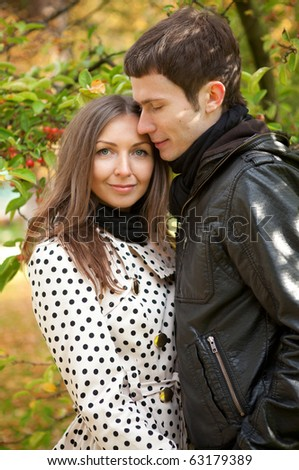 Young beautiful couple at fall - stock photo