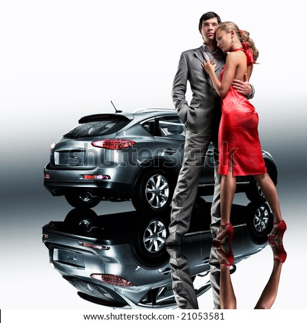 Young beautiful couple end car reflects in the mirror - stock photo