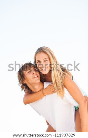 young beautiful couple enjoying a summer day together - stock photo