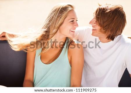 Young beautiful couple having fun in a beach bar - stock photo