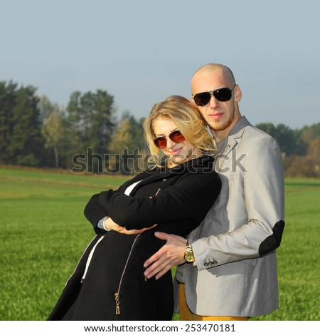 young beautiful couple having fun outdoors. Young happy couple outdoor portrait. Beautiful boy and girl have fun in the field. - stock photo