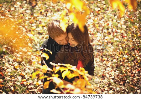 Young beautiful couple in autumn park - stock photo