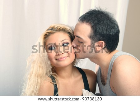 young beautiful couple in bed - stock photo