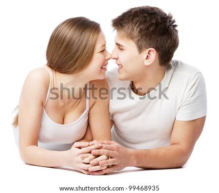 Young beautiful couple isolated on white background - stock photo