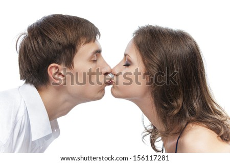 Young beautiful couple kissing, isolated on white background. - stock photo