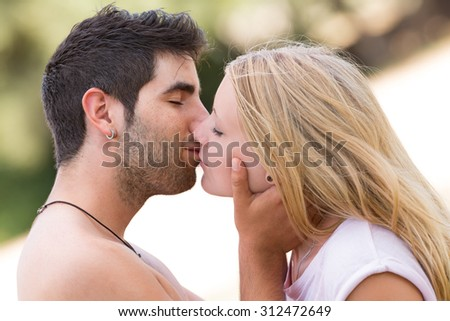 young beautiful couple kissing,selective focus