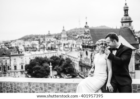 Young beautiful couple look at each other - stock photo