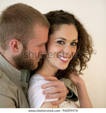 Young beautiful couple of man and woman in love hugging each other,