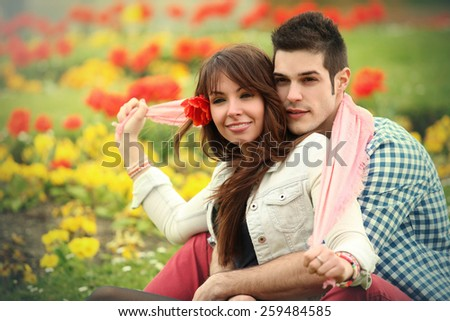 young beautiful couple relaxing in one of  parks in London - stock photo