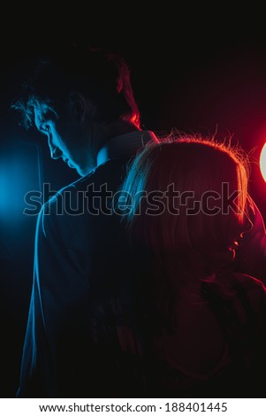 Young beautiful couple silhouette in Black and White - stock photo
