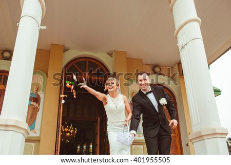 young beautiful couple throwing sweets - stock photo
