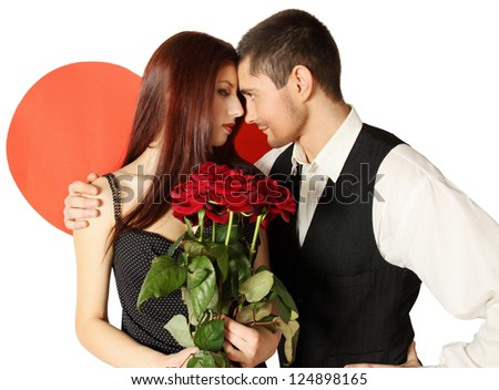 Young beautiful couple with a bouquet of roses - stock photo