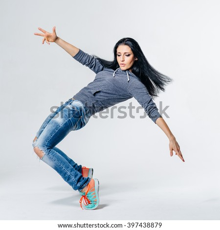 Young beautiful dancer jumping in studio