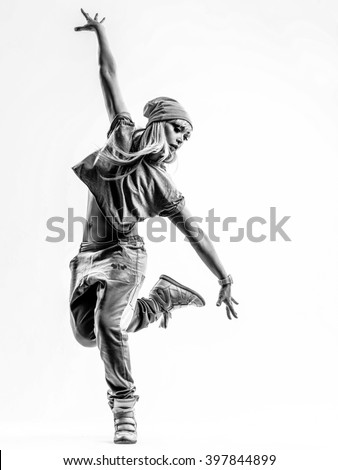 Young beautiful dancer jumping in studio - stock photo