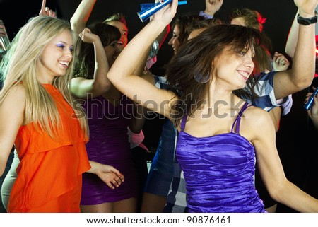 Young beautiful dancing woman at disco - stock photo