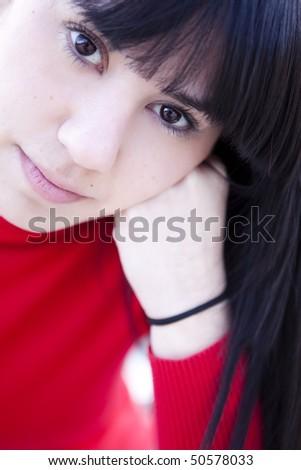 Young beautiful dark haired girl staring at camera. - stock photo