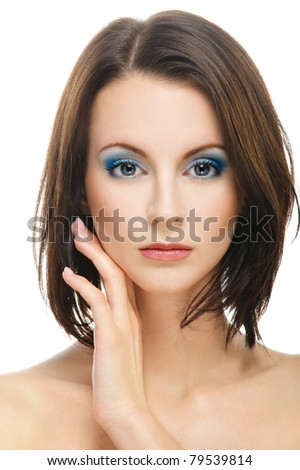 Young beautiful dark-haired woman with bared shoulders has put to cheek back part of palm, isolated on white background. - stock photo