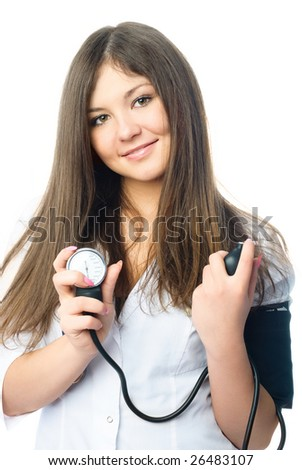 young beautiful doctor dressed in white uniform measuring her blood pressure - stock photo