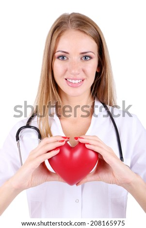 Young beautiful doctor holding red heart isolated on white