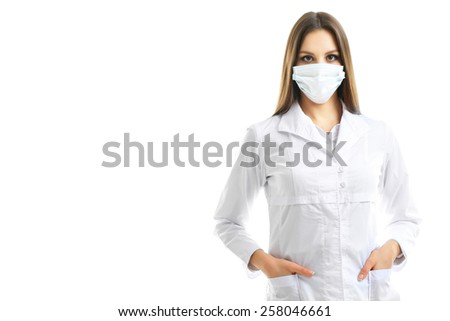 Young beautiful doctor in medical mask isolated on white - stock photo