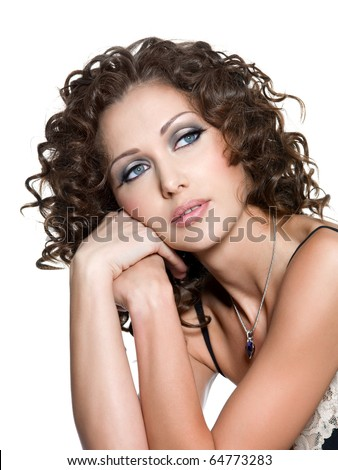 Young beautiful face of woman with fashion makeup and curly hair. Isolated on white - stock photo