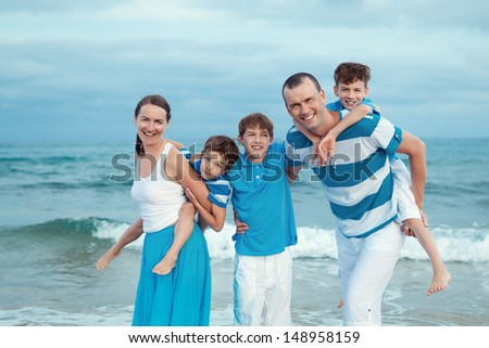 Young beautiful family with tree kids on vacation - stock photo