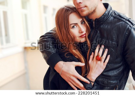 Young beautiful fashion couple in clove posing outdoor in autumn  - stock photo