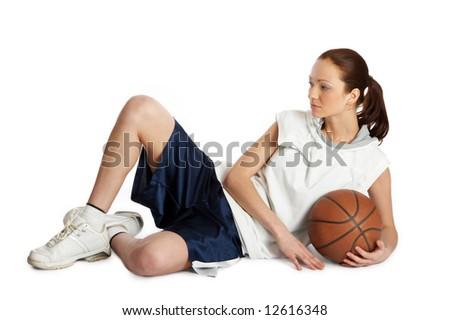 Young beautiful female basket ball player - stock photo