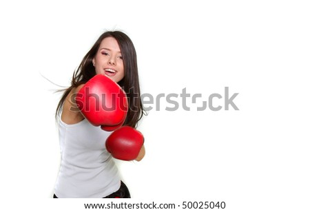 young beautiful female boxer over white - stock photo