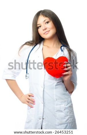 young beautiful female cardiologist with a heart shaped pillow - stock photo