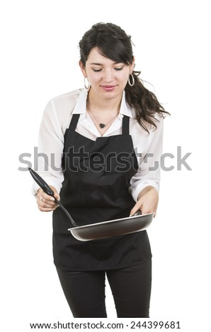 young beautiful female chef wearing black apron cooking holding pan isolated on white - stock photo