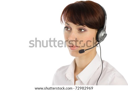 Young beautiful female customer service operator with wired headset isolated on white background - stock photo