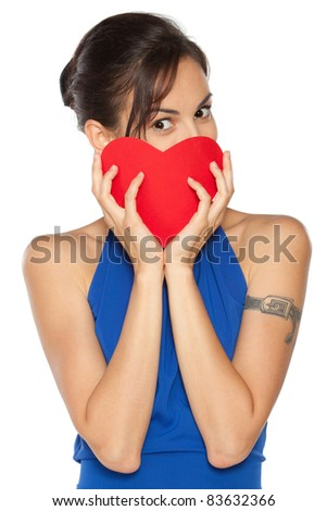 Young beautiful female in blue dress peeking from the heart shape isolated on white background - stock photo